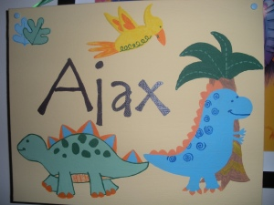 My cousin's wife, Fawn, made this for Ajax's room, which matches his dino theme.  Thanks Fawn!  Ajax tried to eat it as soon as we opened it. lol.