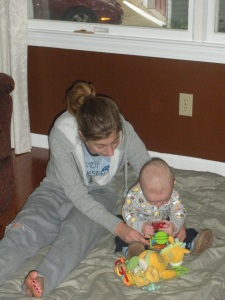 Aunt Lisa and Ajax playing on the floor.